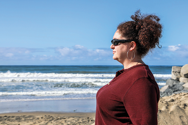 Public health professor Kari Sant looks out at the ocean at Imperial Beach.