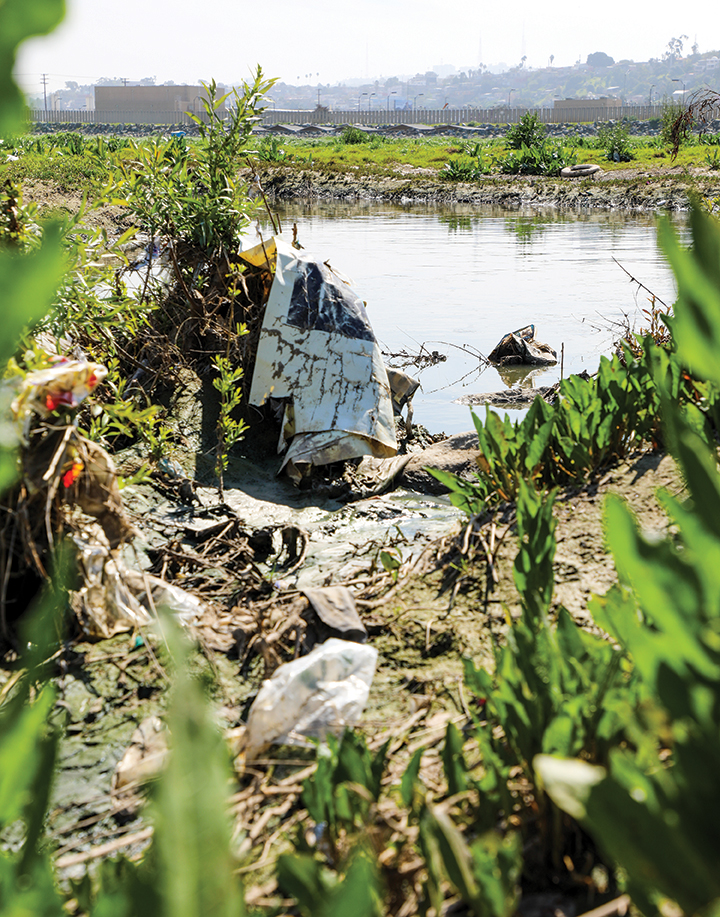 Debris and pollution in the Tijuana River.