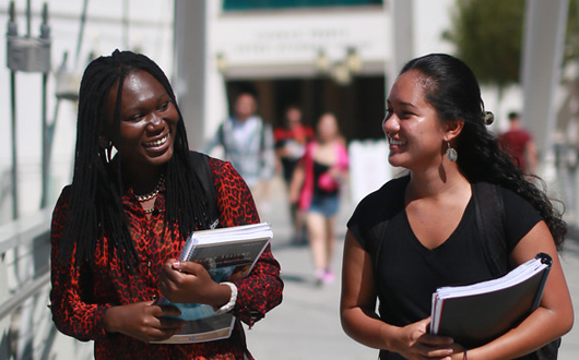 Two female students conversing